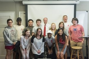 Dr. Bell in an indoor group photo with Coca-Cola Scholars.