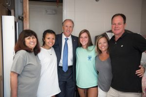 Dr. Bell poses with two students and their parents at 2017's Fall Move in Day