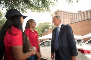 Dr. Bell talking with students outside