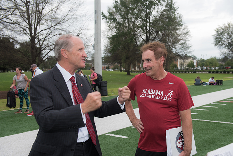 Dr. Bell talks with the director of the Million Dollar Band outside