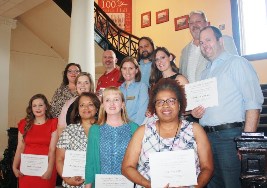 2019 Professional Staff Assembly Award Winners hold awards on the stairs in Smith Hall